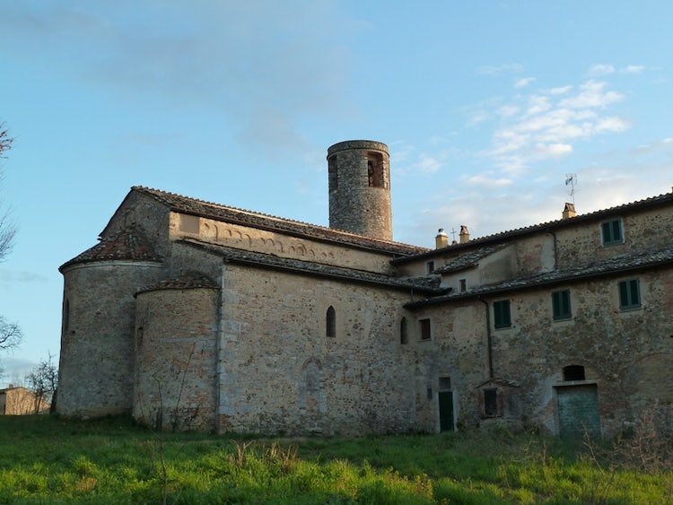 Round bell tower of Pacina Church in Chianti