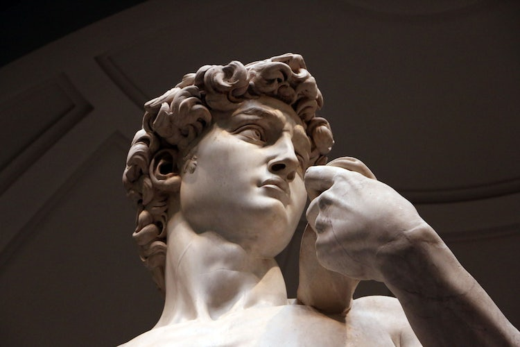 A close up to the original David at the Accademia Museum in Florence