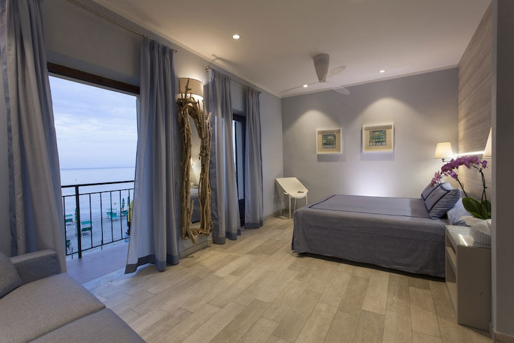 Bedroom with an ocean view at Hotel Ilio