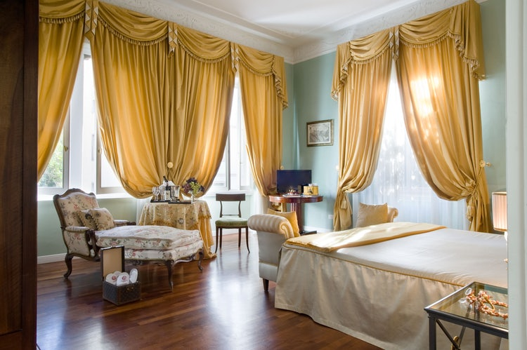 Luxury bedroom in in an authentic Tuscany villa rental