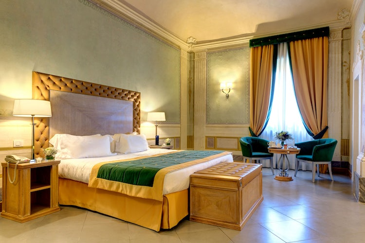Deluxe bedroom at Villa Tolomei